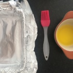Lightly grease your foil-lined dish with melted butter