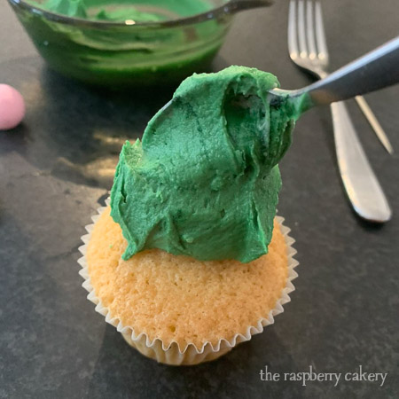 Step 1 - dollop a spoonful of buttercream onto your cupcake (Easter Bunny Cupcakes Tutorial)