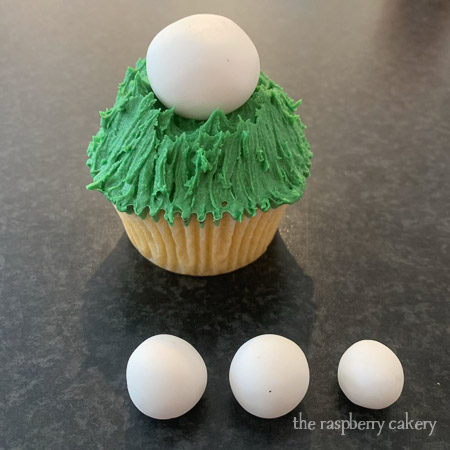 Step 4 - Place the large ball in the middle of the cupcake. (Easter Bunny Cupcakes Tutorial)